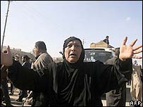 A woman mourns at a Baghdad funeral