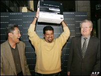 The first PS3 is sold in the US. Angel Paredes with Kaz Hirai (left) and Howard Stringer (right)