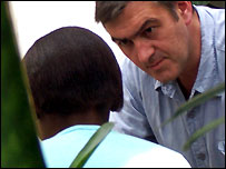 The BBC's Mike Williams interviews a teenagers in Haiti