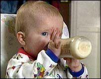 Image of a baby bottle feeding