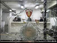 A bullet hole in the window of a Sao Paulo police station