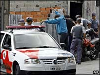 Sao Paulo police stop people at a checkpoint