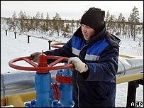 Worker opens a valve on a gas pipeline in Siberia