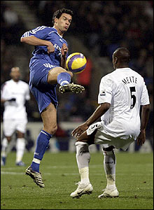 Michael Ballack is confronted by Bolton's Abdoulaye Meite