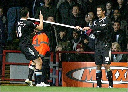 Joey Barton is congratulated by Manchester City team-mate Bernardo Corradi