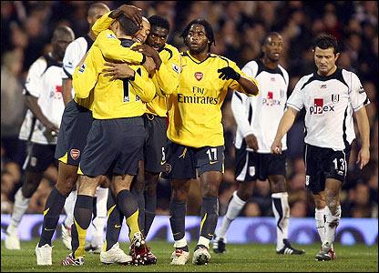 Robin van Persie is mobbed by his Arsenal team-mates