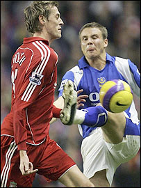 Liverpool striker Peter Crouch (left) and Pompey left-back Matthew Taylor