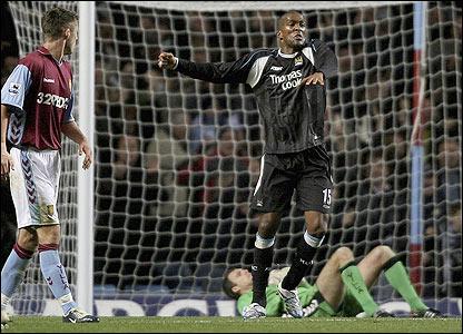 Sylvain Distin celebrates scoring Manchester City's third