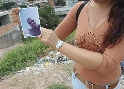 Rogerio's widow holds his photo