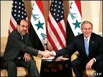 Mr Bush (right) meets Mr Maliki