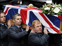 RAF pall bearers carry Flt Lt Al Squires' coffin out of Nairn Old Parish Church