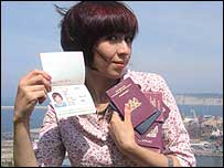 Shahida holding some of her new fake passports