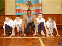 Michael Johnson with pupils at Dalmarnock Primary School
