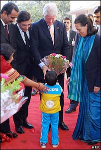 Bill Clinton (centre) meets a HIV-positive child in Delhi