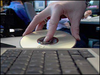 A cd being loaded into a computer