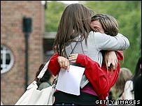 students hugging