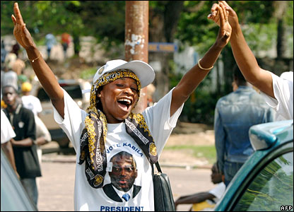 A Kabila supporter celebrates in the Democratic Republic of Congo