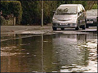 Flood water from a burst main in Thames Ditton