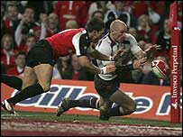 Wales captain Gareth Thomas scores the opening try