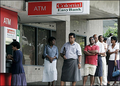People withdrawn money from a cash machine in Suva on 30 November 2006