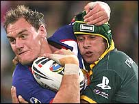 Great Britain's Gareth Ellis is wrapped up by Australia's Johnathan Thurston