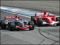 McLaren's Kimi Raikkonen battles with Ferrari's Michael Schumacher in the 2006 Brazilian Grand Prix