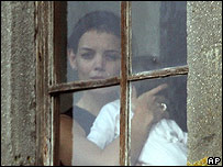 Katie Holmes at a castle window