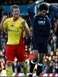 Jay DeMerit celebrates his goal as David James rues his mistake