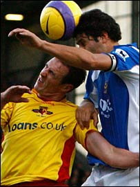 Dejan Stefanovic rises above Malky Mackay to get his head to the ball