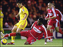 Middlesbrough midfielder Jason Euell tackles Liverpool winger Mark Gonzalez