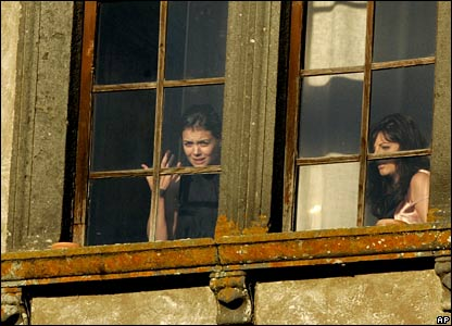 Katie Holmes (l) looks out from a window of the Odescalchi castle before her wedding