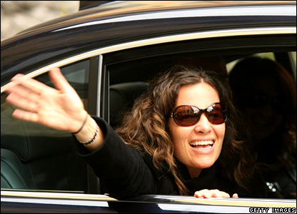 Roberta Armani waves as she arrives at the Odescalchi castle