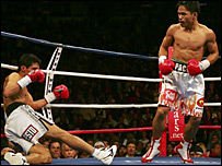 Manny Pacquaio puts Erik Morales onto the canvas during their bout