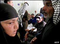Wounded Iraqis receive treatment in Hilla on 19 November 2006
