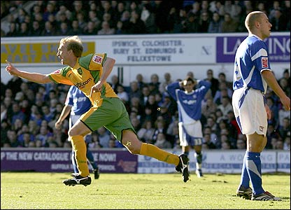 Luke Chadwick wheels away in delight after scoring for Norwich