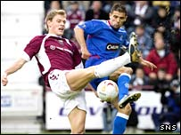 Hearts defender Marius Zaliukas (left) tussles for the ball with Nacho Novo