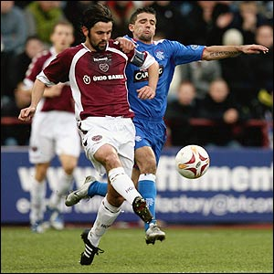 Paul Hartly powers past Nacho Novo