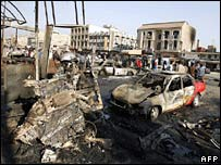 Wreckage at the scene of a triple bombing a at Baghdad bus station
