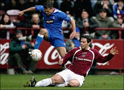 Nacho Novo skips over Julien Brellier of Hearts