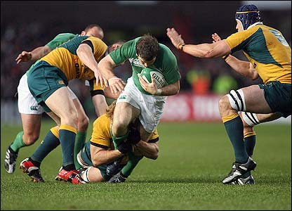 Ireland's Gordon D'Arcy bursts through the Australian defence