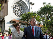 Bush and Laura Bush outside Cua Bac church