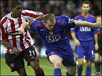 Leigertwood y Rooney.