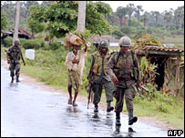 Sri Lankan soldiers patrol a section of the A9 highway