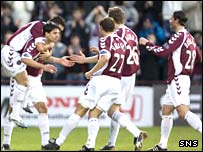 Takis Fyssas is congratulated by his team-mates after opening the scoring