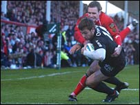 Vincent Clerc crosses for a try under the challenge of Mark Jones
