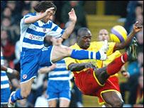 Stephen Hunt and Dan Shittu battle for possession