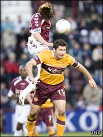 Saulius Mikoliunas (top) has the beating of Motherwell's Jim Paterson