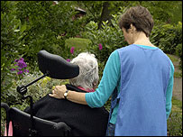 Woman talking to patient in wheelchair