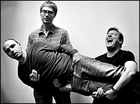 Ricky Gervais (right), Stephen Merchant (left) and Karl Pilkington (carried)