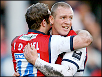 Gloucester's James Simpson-Daniel and Mike Tindall celebrate